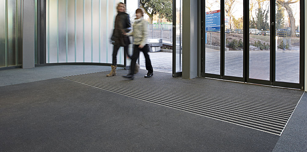 An image of barrier matting that is fitted flush with the flooring.
